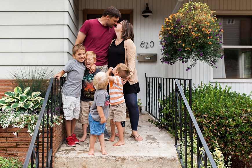 in home family photography, lacey monroe photography, family standing on front steps of house