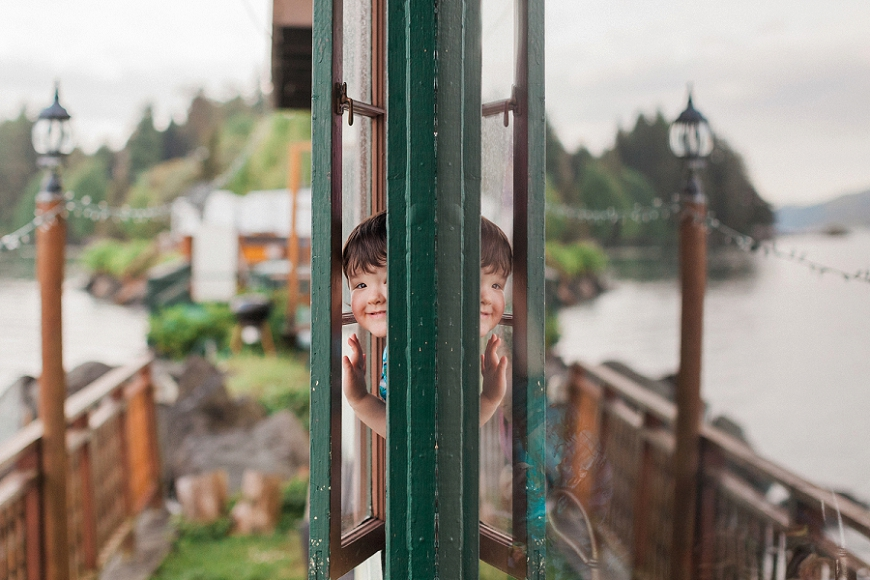 lacey monroe photography, little boy looking out window, puget sound, hood canal