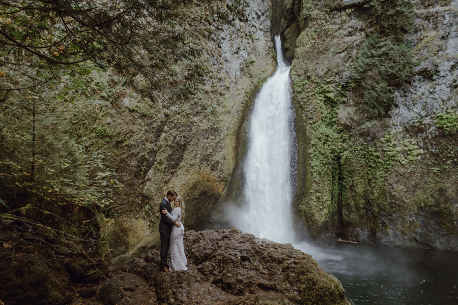 A portrait of a bride and groom at Wahclella Falls