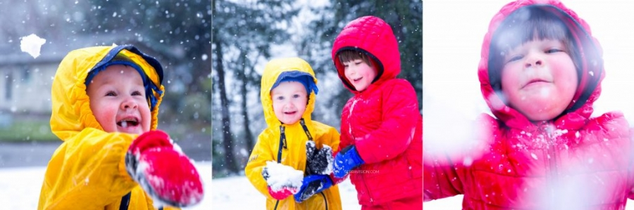 Two preschool boys wearing bright colored red and yellow snow suits play in the snow outside in a portland oregon park