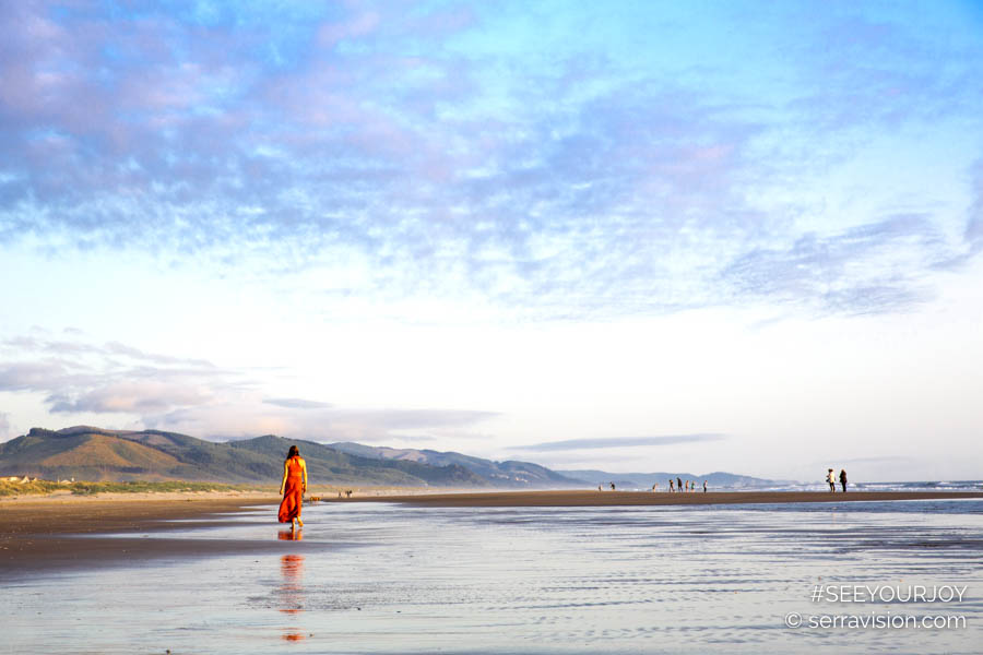 former professional ballerina walks through the surf at Manzanita Beach